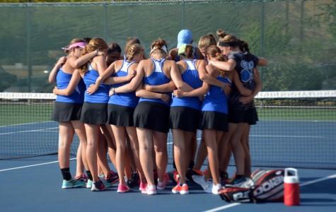 OHS girls tennis causing a racquet