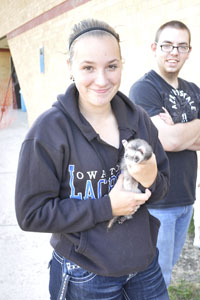 Rhianne Lustig poses with a ferret during the FFA petting zoo