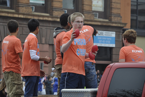 Junior Jack Livingston throwing out footballs during the parade