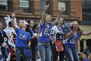 Owatonna High School tailgaters getting the crowd pumped up during the parade
