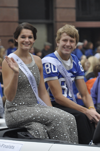 Kalley Schwab and Jacob Woodrich smile at the camera sporting their homecoming sashes