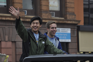 Ryan Huang and Michael Ditlevson smile toward the crowd