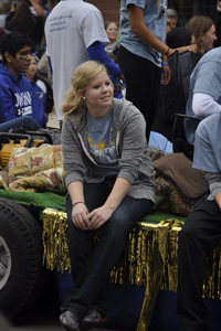 Kylee Johnson rides the National Honors Society float to finish out the parade