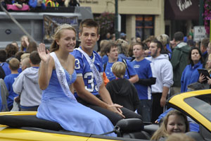 Nicole Sedivy and Martin Gleason ride through the parade rout