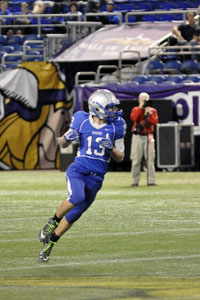 Aaron Peterson runs through the field at the State Football Game.