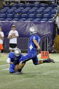 Senior Carter McCauley winding up for a field goal.