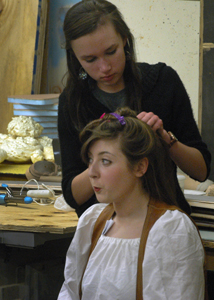 Mady Vieths sits patiently while being transformed into Peter Quince, director of the mechanicals