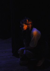 Puck (Jaylin Evert) hides from Titania (Ella Rasp) during A Midsummer Night's Dream.