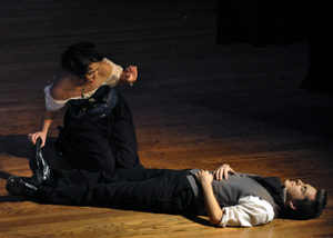 Helena (Maureen Gleason) wakes up Lysander (Nick Beck) during Sunday's performance.