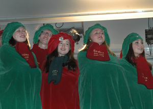Junior Maria Versteeg, senior Matthew VanOmmeren, junior Megan Nowariak, junior Jackie Warehime, and junior Anna Moe perform with the Owatonna Carolers on Thursday for the Festival of Lights in Central Park.