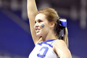 Senior Anna Redman cheers at the state football game.
