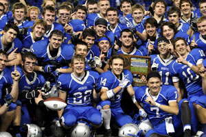 The OHS football team celebrating their victory against Brainerd in the finals for state.