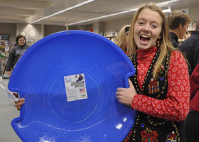 Senior Aliyah Waypa proudly displays her prize, a sled