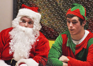 Santa (Josh Dub) and his elf (Luke Wanous) sigh after bingo is done