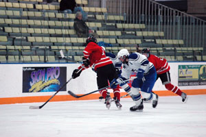 Dallas Hegard goes for the puck