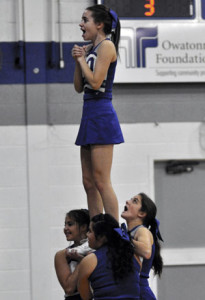 Cheerleaders hold Peyton Lindholm up