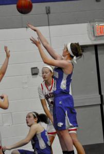 Katlin Ptacek shoots as teammate Kirstin Pumper looks on