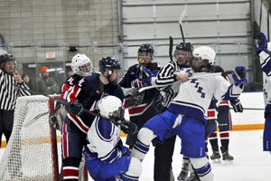 Jordan Klein and Trase Wencl being pulled off the pile infront of the net