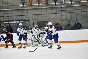 Austin Dalland , Kade Friedrichs and Aaron Kirsch heading up the ice