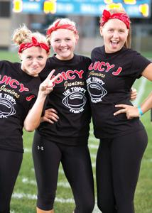 Juniors Krista Kniefel, Kayla Kniefel, and Olivia Oland prepare for the 2013 Powderpuff game.