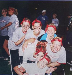 Senior Powder Puff football team of 2002: Amanda Sweet, Katie Schrom, Tara Jenkins, Andrea Harris, Amber Zak, and Dana Phillips take time to enjoy their victory over the juniors who will of course have their time of glory next year.
