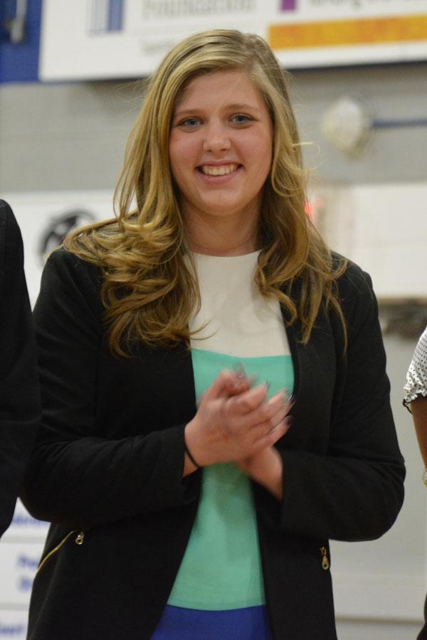Freshman Britta Gantert smiles as she waits to receive her ribbon