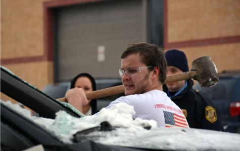 Senior Shane Gardner get mad while smashing the car
