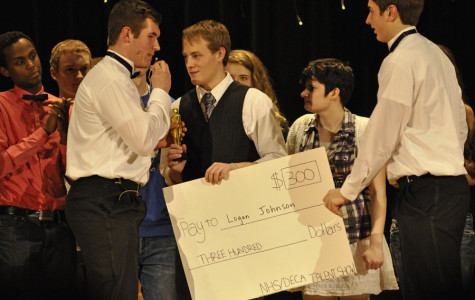 NHS Talent Show winner Logan Johnson collects his check from emcees Luke Wanous and Timon Higgins
