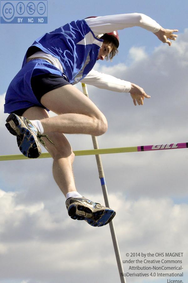Zach Dantzman flies over the bar while pole vaulting
