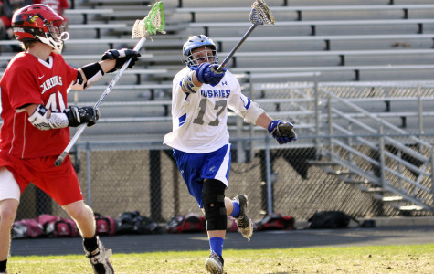 Ethan Pfieffer reaches out to steal the ball from his opponant