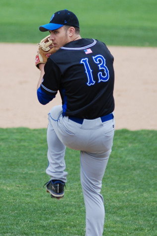 Senior Riley Thompson winds up for a pitch