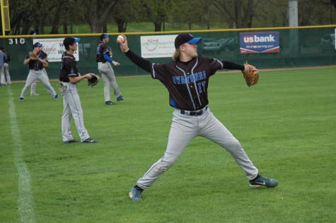 Junior Brady Steinhorst warms up before their game