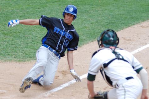 Junior Isaac Rocha slides into home base