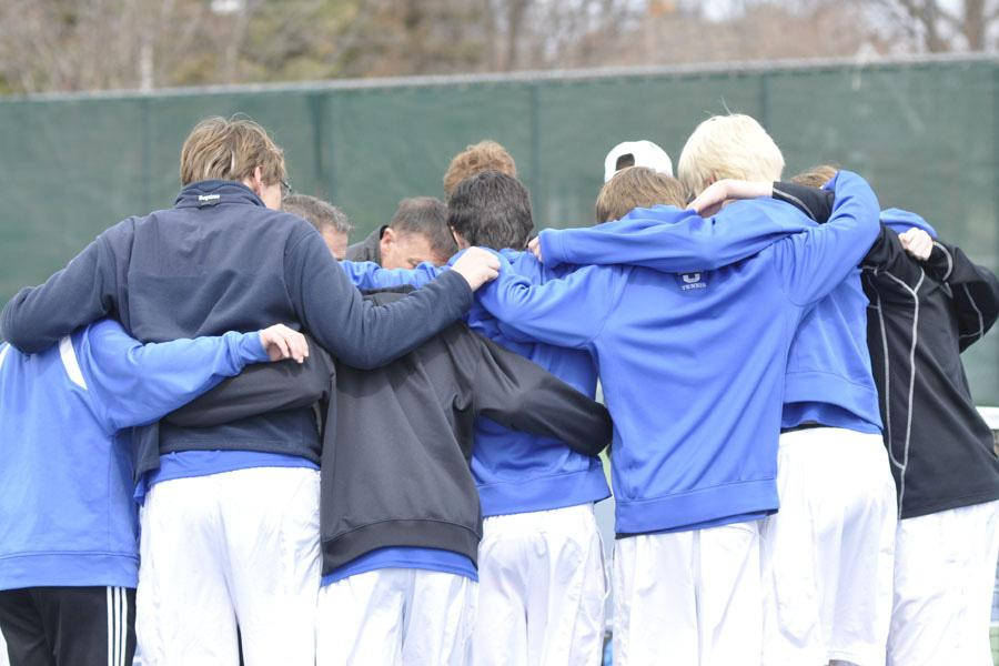The Owatonna Boys Tennis team huddle up before the matches begin.