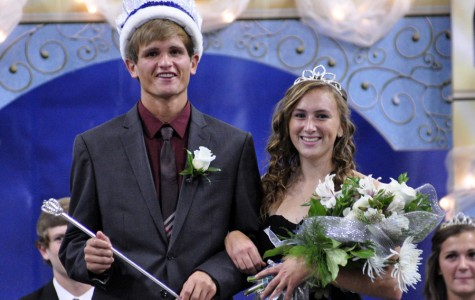 Homecoming King Dexter Leer and Queen Abby Bendorf smile for their friends and family