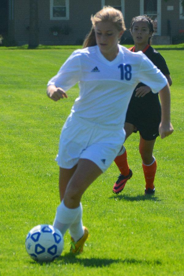 Jenna Bogen moves the ball down field