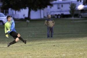 Layne Frank kicks the ball away