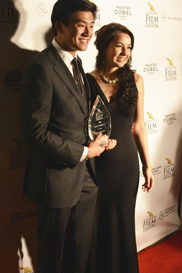 Ryan Huang and Maureen Gleason pose on the red carpet with their award for Best Student Film