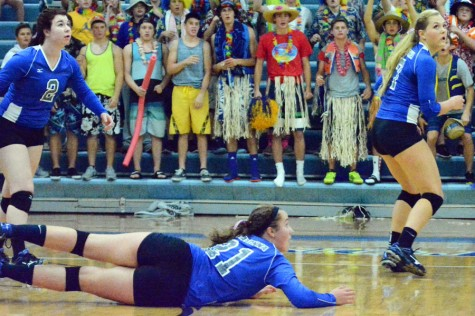Freshman Olivia Spatenka diving after the ball