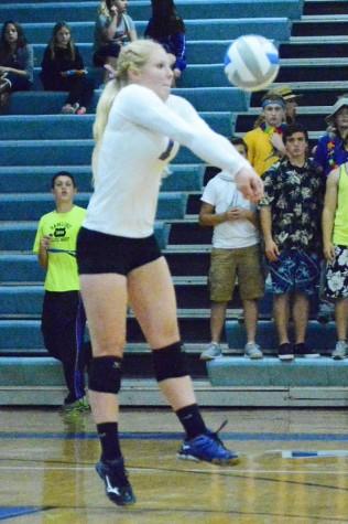 Senior captain Kaylea Ahrens bumps the ball