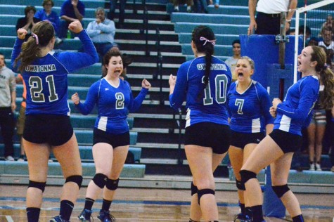 Owatonna volleyball team celebrating after a point