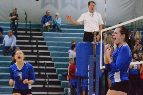 Junior Carli Langeland and senior captain Elly Buck celebrating after a point