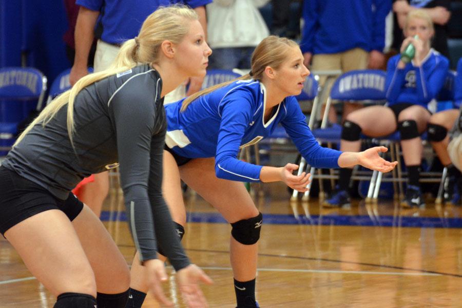 Senior Kaylea Ahrens and senior Marandes Schultz preparing to return a serve.