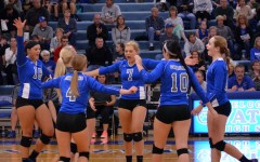 Owatonna volleyball celebrating after a point. Pictured: Sophomore Lexi Langeland Senior Kaylea Ahrens  Senior Marandes Schultz Junior Carli Langeland  Senior Elly Buck Freshmen Sydney Schultz