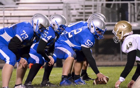 Owatonna football's offensive line mans up to make a play