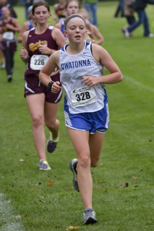 Junior Hannah Cochlin runs at the Ev Burg meet