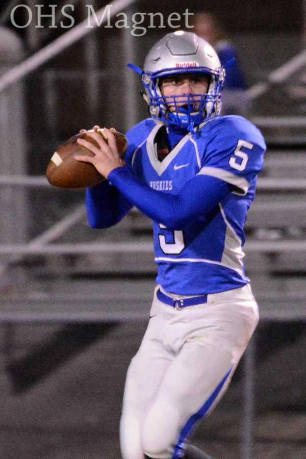 Quarterback Alex Emanuelson looks to pass