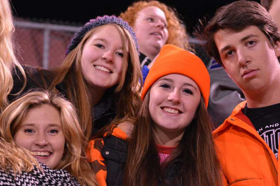 Student Section members fight the cold as their team fights the Austin Packers