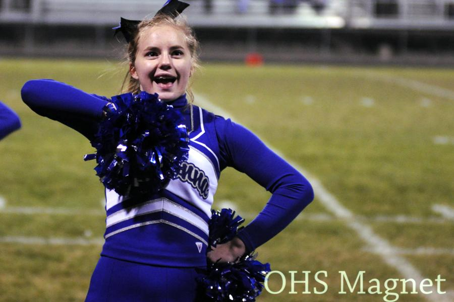 Tonya Wolff cheers after a Husky touchdown