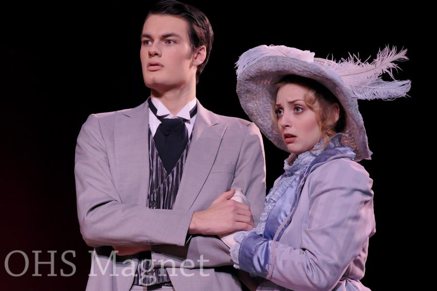 Thomas Donlon and Jessica Friedman, playing Ernest Worthing and Gwendolen Fairfax. The love interests hold each other in the midst of hearing bad news